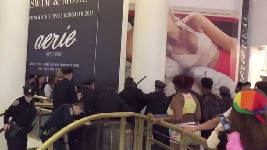 Video taken at the Westfield Mall in San Francisco shows officers trying to break up large fight Sunday night. (@GeorgeTheCat, Twitter)