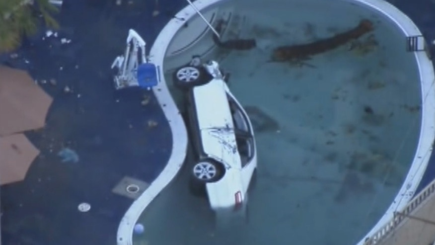 An SUV crashed into a motel pool in the San Pedro community in Los Angeles Sunday night, injuring eight people, including the driver. (KTTV)