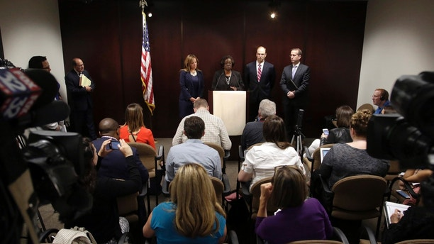 Special prosecutor Patricia Brown-Holmes, center, speaks during a news conference Tuesday, June 27, 2017 in Chicago. Brown-Holmes announced that three Chicago police officers have been indicted on felony charges that they conspired to cover up the actions of a white police officer who shot and killed 17-year-old Laquan McDonald. In the indictment approved Monday by a Cook County grand jury, alleges that one current and two former officers lied about the events of Oct. 20, 2014 when Officer Jason Van Dyke shot the black teenager 16 times. (AP Photo/G-Jun Yam)
