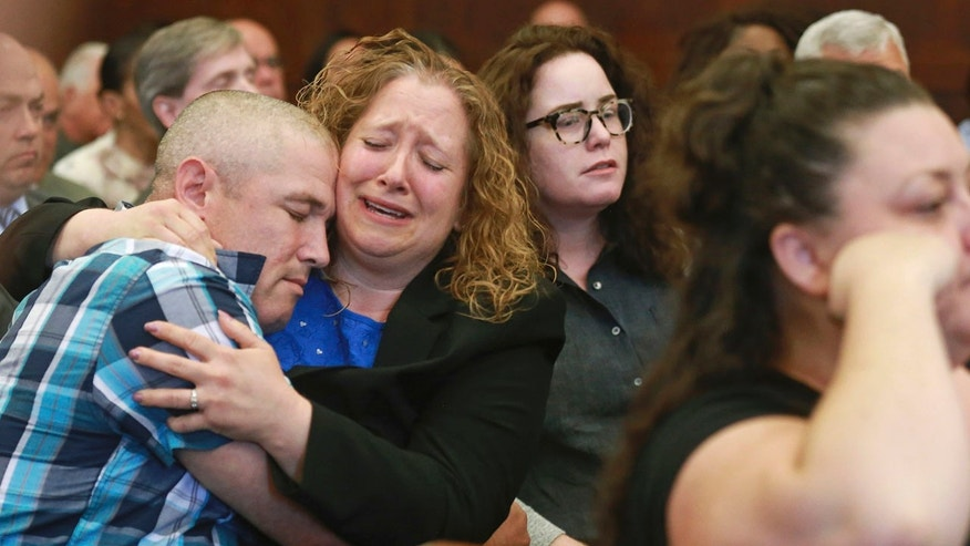 June 26: Michael Sprinsky, far left, gets a hug from his sister Laura Sprinsky, as the guilty verdict is read of second degree murder for defendant Michael P. McCarthy