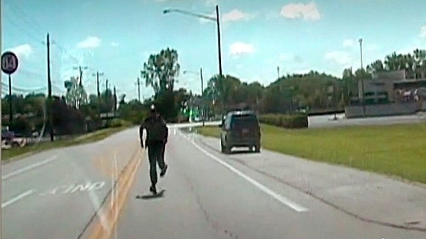 Deputy caught on camera chasing after patrol vehicle