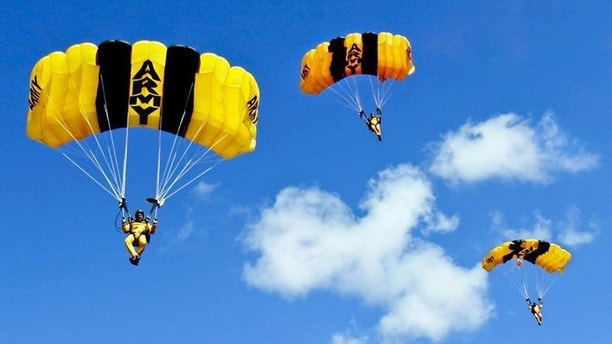 U.S. Army Parachute Team members prepare to land on target as part of the Golden Knights annual certification cycle on Homestead Air Reserve Base, Fla., Jan. 27, 2014.
