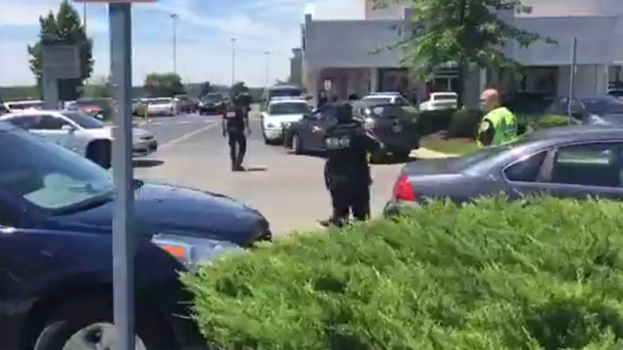 Police respond to a shooting at the 100 Oaks Mall in Nashville.