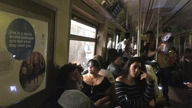 This photo provided by Jackie Faherty from her Twitter page shows subway passengers on an A train with the lights out after it halted just shy of the 125th street stop in New York's Harlem neighborhood, Tuesday, June 27, 2017, in New York. The New York Police Department says a minor derailment in Harlem caused a power outage that led to evacuations along the subway line. (Jackie Faherty via AP)