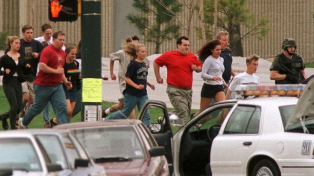 "April 20, 1999: Two heavily armed teenagers Eric Harris and Dylan Klebold go on a rampage at Columbine High School in Littleton, Colorado, shooting 12 students and a teacher to death and wounding more than 20 others before taking their own lives. REUTERS/Gary Caskey/File Photo           FROM THE FILES PACKAGE - SEARCH ""MASS SHOOTINGS FILES"" TO FIND ALL IMAGES - RTX2FV8T"