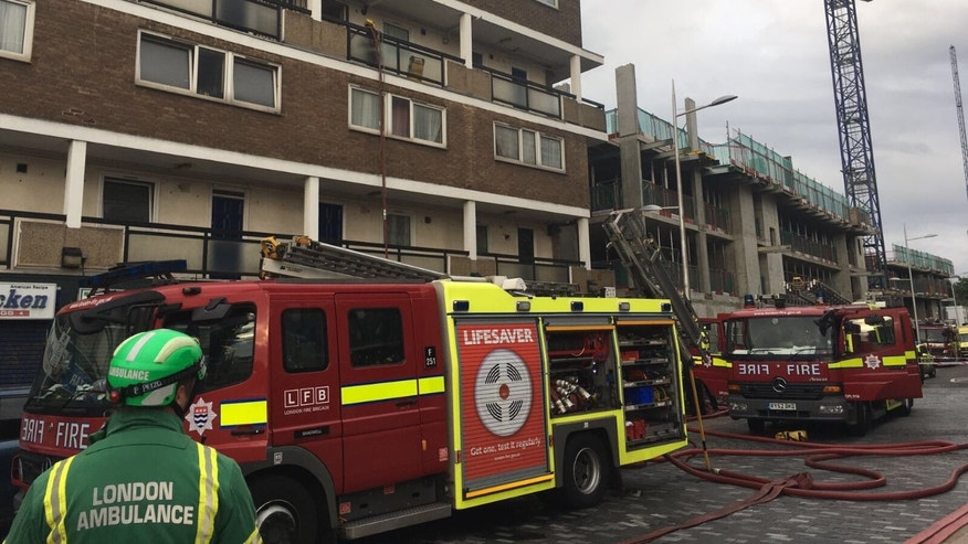 London Ambulance subdues the fire at a London building Monday morning. (London Ambulance)