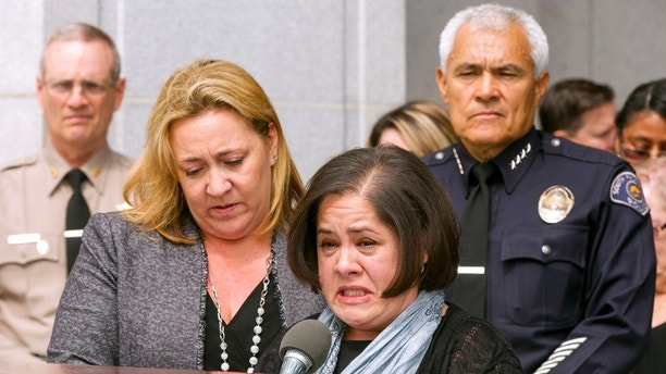 "FILE - In this May. 17, 2017, file photo, Ana Estevez, center, the mother of Aramazd Andressian Jr., a 5-year-old boy who has been missing for several weeks from South Pasadena, Calif., is helped by an unidentified family friend, left, with South Pasadena Police Chief Arthur Miller, right, as they join Sheriff's officials at a news conference outside the Hall of Justice in Los Angeles. Homicide detectives have found the body of a missing 5-year-old boy whose father is charged with his murder, authorities announced Saturday, July 1, 2017. Based on ""additional leads,"" detectives returned Friday to an area near Lake Cachuma in Santa Barbara County and found the remains of Aramazd Andressian Jr., according to a statement from the Los Angeles County Sheriff's Department. (AP Photo/Damian Dovarganes, File)"