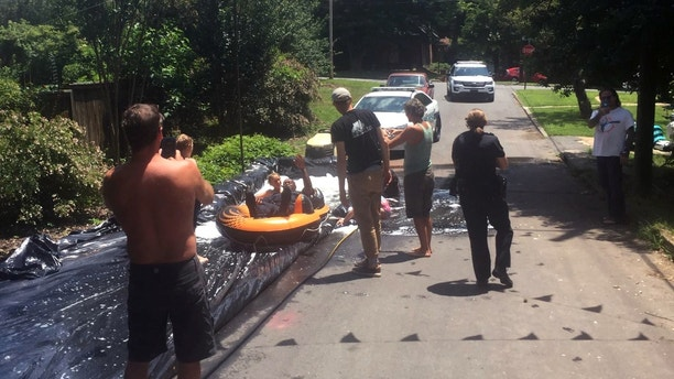 NC police officers take ride on slip 'N slide