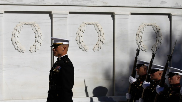 Nov. 11: The U.S. Marine Corps Honor Guard stands during the wreath ceremony at the Tomb of the Unknowns in honor of Veterans' Day at Arlington National Cemetery in Arlington, Va.