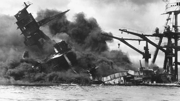 The battleship USS Arizona sinks after being hit by a Japanese air attack on Pearl Harbor, Hawaii, December 7, 1941. Picture taken December 7, 1941.    The U.S. National Archives/Handout via Reuters  ATTENTION EDITORS - THIS IMAGE WAS PROVIDED BY A THIRD PARTY. EDITORIAL USE ONLY - RTSUVDN