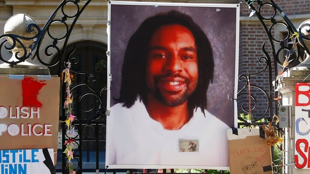 FILE - In this July 25, 2016, file photo, a memorial including a photo of Philando Castile adorns the gate to the governor's residence where protesters continue to demonstrate in St. Paul, Minn., against the July 6, 2016, shooting death of Castile by St. Anthony police Officer Jeronimo Yanez during a traffic stop in Falcon Heights, Minn. Yanez is expected to enter his plea on manslaughter charges during a hearing Monday, Feb. 27, 2017. (AP Photo/Jim Mone, File)
