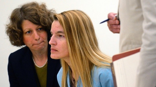 FILE - In this Tuesday, Aug. 25, 2015, file photo defendant Jody Herring, center, of Barre Town, Vt., is flanked by defense attorneys Kelly Green, left, and David Sleigh at her arraignment in Washington County Criminal Court in Barre, Vt. The prosecutor and the defense attorney in the case of Herring, charged with killing three relatives and a social worker in 2015 are set to discuss the status of the case with a judge on Thursday, July 6, 2017. A judge set an Aug. 1 trial date. Herring has pleaded not guilty to murder charges. (Stefan Hard/The Times Argus via AP, Pool)