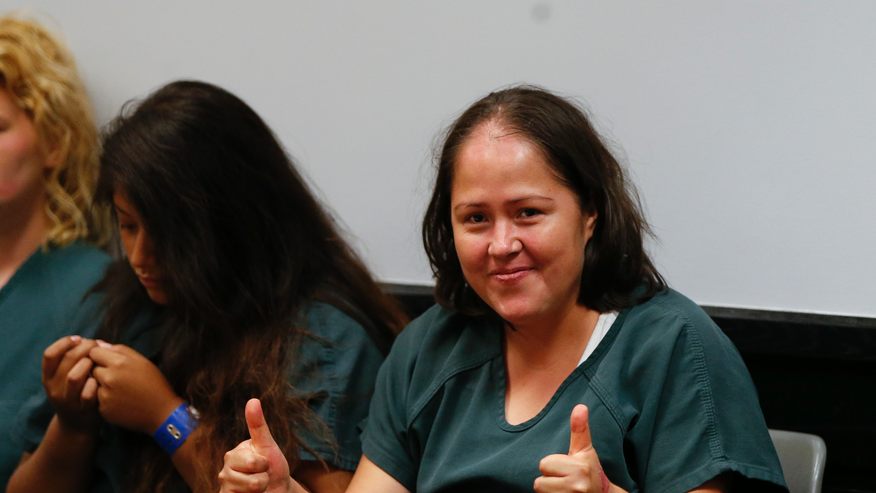 Woman Charged With Killing Her Husband & Children Smiles In Court