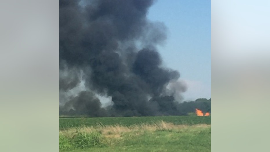 Smoke rises from the site where a Marine KC-130 refueling plane crashed in Leflore County, Miss., Monday evening.