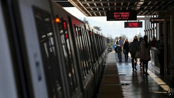 Passengers depart from a Bay Area Rapid Transit (BART) train at the Rockridge station in Oakland, California February 12, 2015. Tens of thousands of commuters on San Francisco's Bay Area Rapid Transit system may have been exposed to measles after an infectious Bay Area resident rode a train to and from work for three days last week, public health officials said on Wednesday. REUTERS/Robert Galbraith  (UNITED STATES - Tags: TRANSPORT HEALTH) - RTR4PDHX