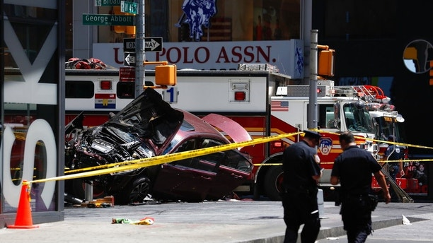 FILE- In this May 18, 2017, file photo, a smashed car sits on the corner of Broadway and 45th Street in New York's Times Square after several were injured when the car was driven into a crowd of pedestrians. Richard Rojas, who is accused of mowing down a crowd of Times Square pedestrians with his car, is scheduled to be in court Thursday, July 13, where he is expected to enter a plea. (AP Photo/Seth Wenig, File)