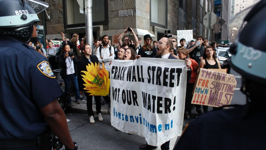 Protesters and police face off during an Occupy Wall Street march in September 2012, in New York.
