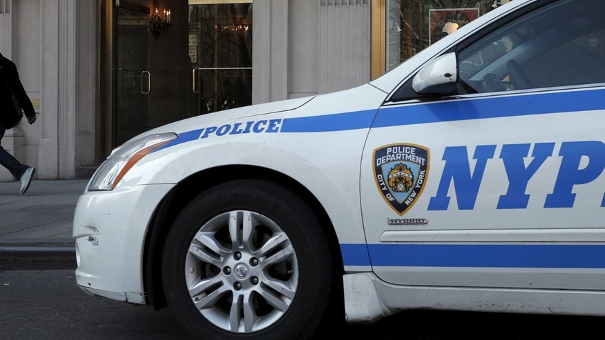A New York City Police (NYPD) car is parked outside an apartment building in Manhattan.