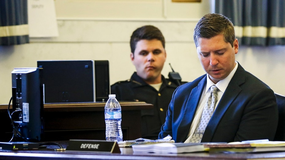 Ray Tensing, a former University of Cincinnati police officer, listens to Assistant Prosecutor Stacey DeGraffenreid.