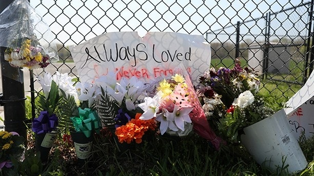 A makeshift memorial stands outside a park, where bodies of four men were found on April 13, in Central Islip, New York, U.S., April 28, 2017. Local media quoted authorities as saying the Central American-based Mara Salvatrucha (MS-13) gang is responsible of the killings. REUTERS/Shannon Stapleton - RTS14DOD