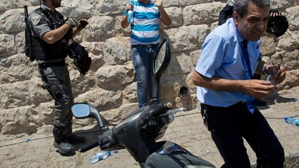 Israeli police officers clash with Palestinians outside the Lion's Gate in Jerusalem's Old City, Wednesday, July 19, 2017. A dispute over metal detectors has escalated into a new showdown between Israel and the Muslim world over a contested Jerusalem shrine that has been at the center of violent confrontations in the past. (AP Photo/Oded Balilty)