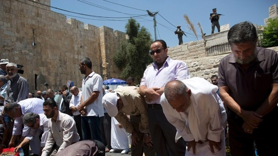 Palestinian Muslims pray outside Jerusalem's Lion's Gate following an appeal from clerics to pray in the streets instead of the Al Aqsa Mosque compound.A dispute over metal detectors has escalated into a new showdown between Israel and the Muslim world over the contested shrine that has been at the center of violent confrontations in the past.