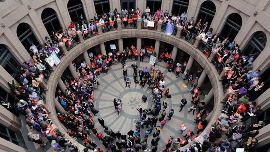 "Opponents of a Texas ""bathroom bill"" protest in the exterior rotunda at the Texas state Capitol in Austin, March 7, 2017."