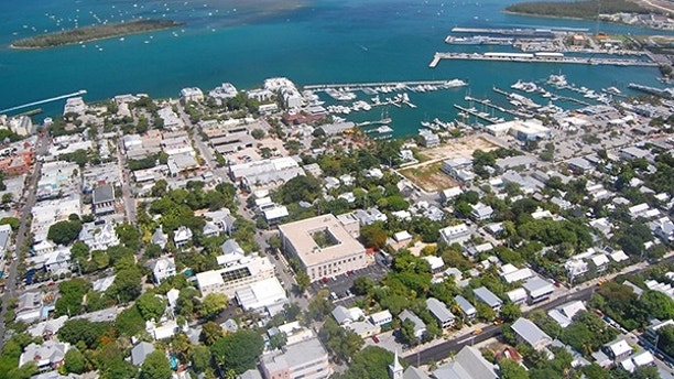 aerial view over Key West looking north with Duval Street and the marina
