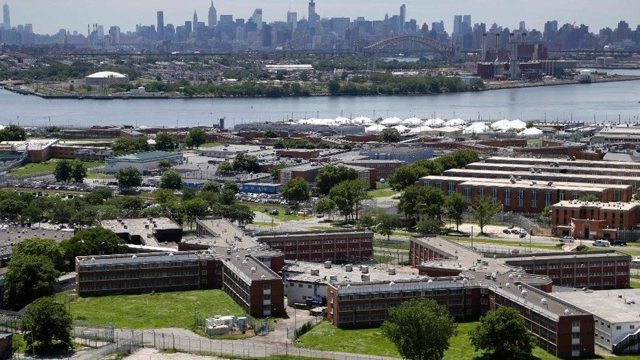 FILE - In a June 20, 2014, file photo, the Rikers Island jail complex stands in New York with the Manhattan skyline in the background.