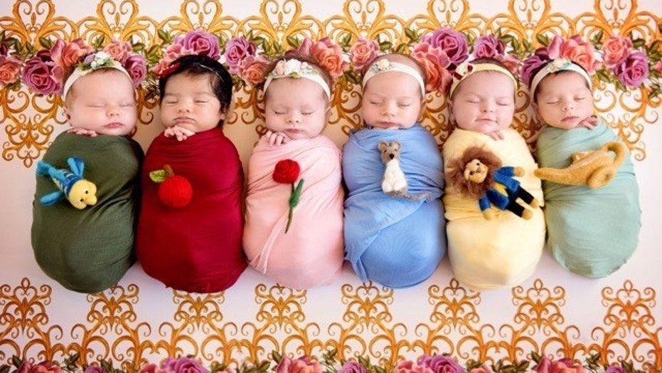Six newborn babies were dressed as Disney princesses and photographed.