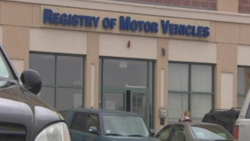 Four Massachusetts RMV workers are accused in a scheme to get fake IDs for illegal immigrants.