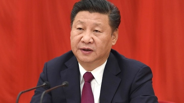 "In this photo released by Xinhua News Agency, Chinese President Xi Jinping, also general secretary of the Communist Party of China (CPC) Central Committee, speaks at the Sixth Plenary Session of the 18th CPC Central Committee, in Beijing on Thursday, Oct 27, 2016. China's Communist Party has elevated President Xi Jinping to the position of ""core"" of the leadership, underscoring the overwhelming clout he has amassed on the back of a sweeping anti-corruption campaign and crackdown on dissent. (Li Xueren/Xinhua via AP)"