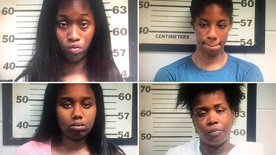 Mugshots for clockwise for top left Lauteshia Dotson, Ponesha Taylor,  Brittany Curry and Johniesha Simmons