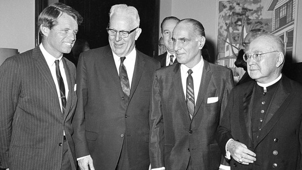 "FILE - In this April 4, 1967, file photo, U.S. Sen. Robert F. Kennedy, from left, Chief Justice Earl Warren of the U.S. Supreme Court, Assembly Speaker Anthony J. Travia, and Francis Cardinal Spellman attend New York State's Ninth Constitutional Convention at the Capitol in Albany, N.Y. Corruption and a rigged political system are battle cries of both sides in a debate over whether New Yorkers should vote this fall to rewrite the state constitution. Advocates of a ""yes"" vote say a constitutional convention is the only way to fix corruption and inefficiency in government. But opponents say a convention would be rife with corruption and could strip away constitutional protections of the environment, labor and reproductive rights. (AP Photo/File)"