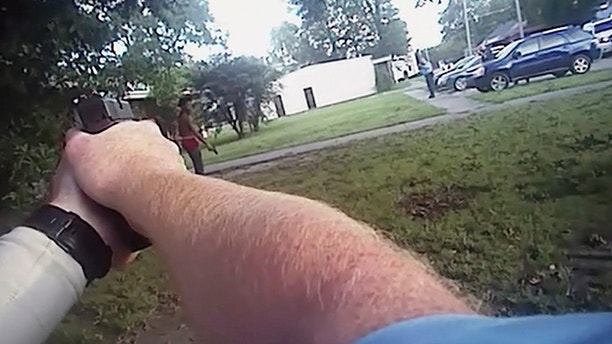 In this image from a July 25, 2017 police body camera video released by District Prosecuting Attorney's Office, Aries Clark, 16, holds a black BB gun that looked like a handgun before he was shot in Marion, Ark. Two eastern Arkansas police officers won't face charges in the fatal shooting of a black teenager outside an emergency youth shelter, a prosecutor said Wednesday, Aug. 9, 2017. (District Prosecuting Attorney's Office via AP)