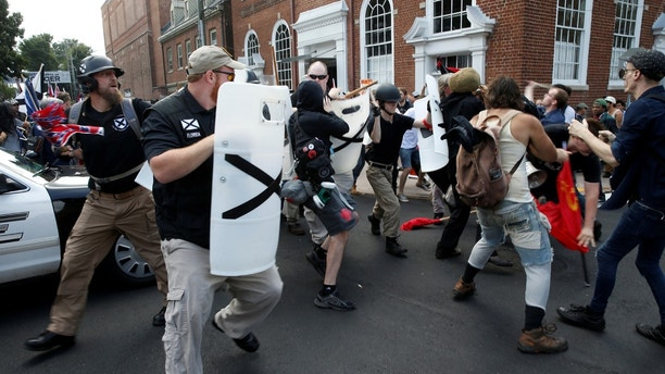 Members of white nationalists clash a group of counter-protesters in Charlottesville, Virginia, U.S., August 12, 2017.   REUTERS/Joshua Roberts - RTS1BICB