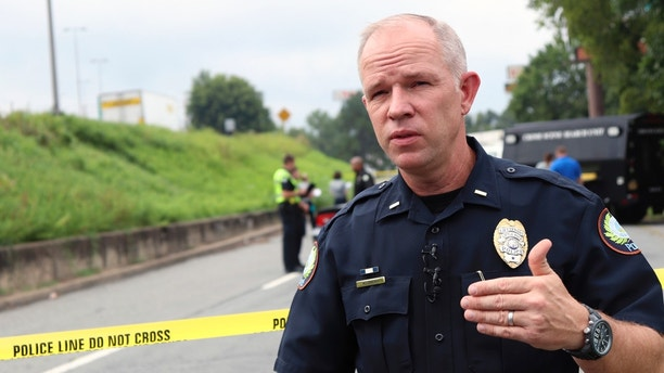 Little Rock Police Lt. Steve McClanahan speaks Monday, Aug. 14, 2017, near an interstate highway in Little Rock, Ark., about the city's increasing number of homicides. The city on Monday matched its homicide total from 2016 and is on a pace to approach the pace from 1993, when gang warfare led to a spike in the city's murder rate. (AP Photo/Kelly P. Kissel)