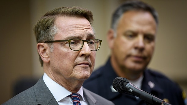 Lexington Mayor Jim Gray and Police Chief Mark Barnard speak at a press conference in Lexington, Kentucky, U.S., August 15, 2017.  REUTERS/Bryan Woolston - RTS1BXZX