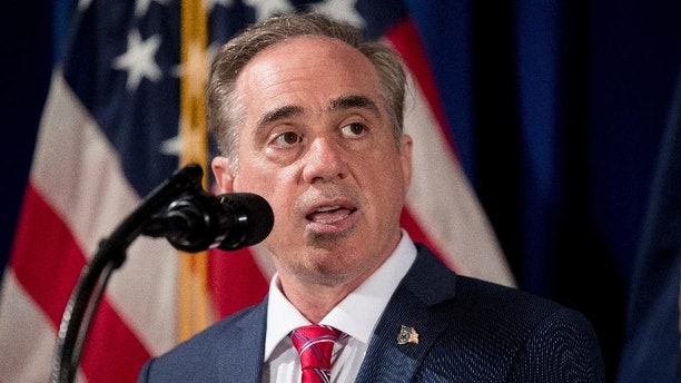 "This photo taken April 27, 2017, shows Veterans Affairs Secretary David Shulkin speaking before President Donald Trump signs an Executive Order on ""Improving Accountability and Whistleblower Protection"" at the Department of Veterans Affairs, in Washington. Shulkin helped dedicate a new home designed to provide nursing and residential care for the state's veterans on Friday,May 5, 2017, saying it sets the standard for the way the nation should be caring for veterans. (AP Photo/Andrew Harnik,File)"