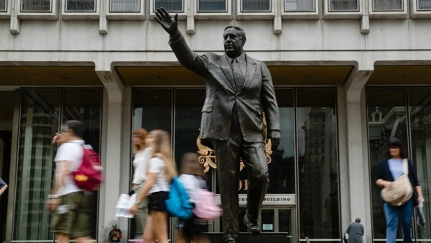 Shown is a statue of the late Philadelphia Mayor Frank Rizzo, who also served as the city's police commissioner, outside the Municipal Services Building in Philadelphia, Tuesday, Aug. 15, 2017.