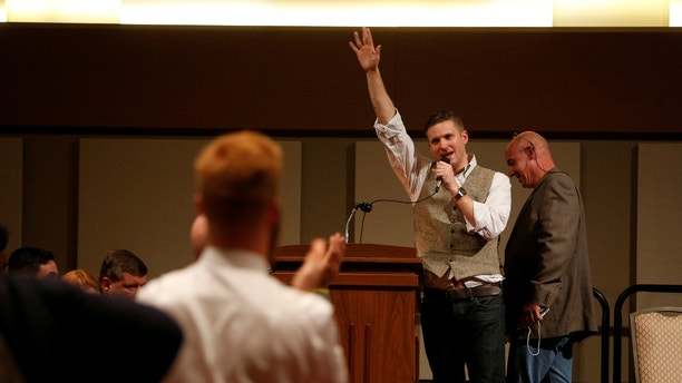 White nationalist leader Richard Spencer of the National Policy Institute waves goodbye after his speech during an event not sanctioned by the school, on campus at Texas A&M University in College Station, Texas, U.S. December 6, 2016. REUTERS/Spencer Selvidge - RTSV06U