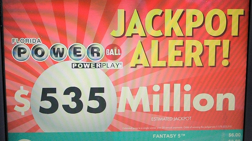 A Powerball Jackpot alert is shown on the screen of a monitor at a gas station, Friday, Aug. 18, 2017, in Hialeah, Fla. An estimated $535 million is set for Saturday night's drawing. (AP Photo/Alan Diaz)