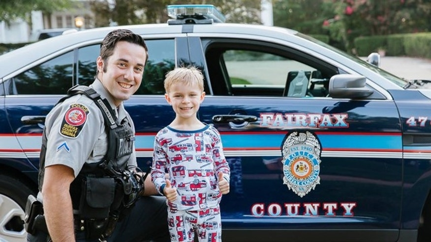 Officers posed with pictures with the boy, named Benjamin.