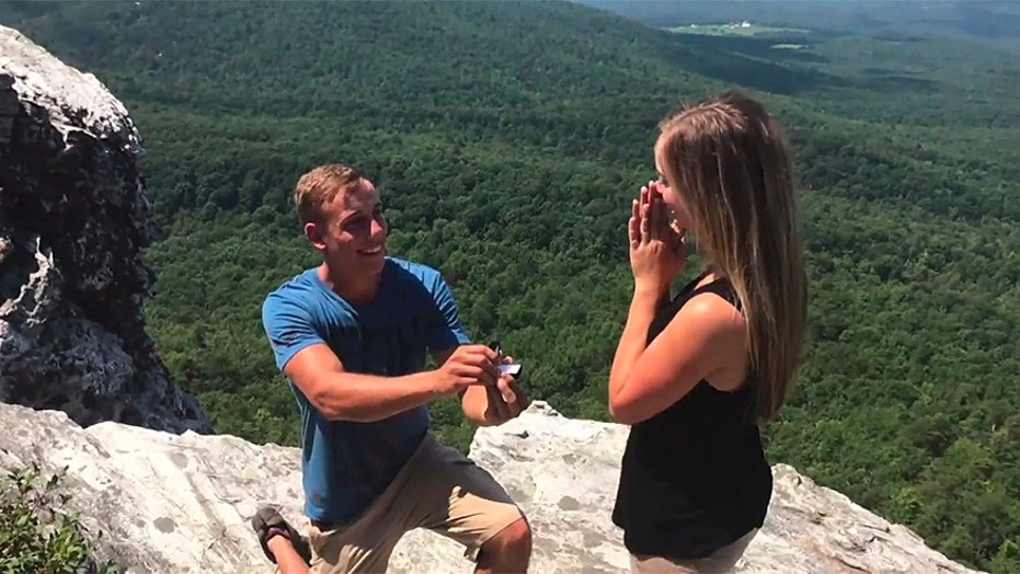 Hunter Sawyers proposed to his girlfriend, Elaina Bullard, with a picture-perfect backdrop during Monday's total solar eclipse.