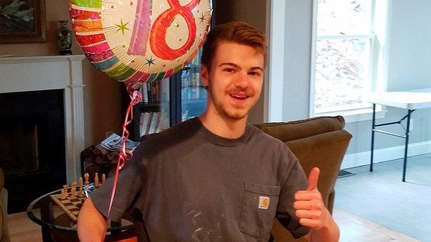 This April 2017 photo provided by his family shows Andrew Oneschuk during his 18th birthday at his family's home in Massachusetts. Devon Arthurs, 18, co-founder of the Atomwaffen Division neo-Nazi group, told police detectives he killed his roommates Oneschuk and 22-year-old Jeremy Himmelman in Tampa, Fla., on May 19, 2017. (Christin Oneschuk via AP)