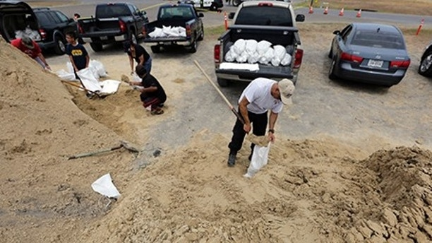 Martin Quintanilla fills sandbags as he and other residents prepare for Hurricane Harvey, Thursday, Aug. 24, 2017, in Corpus Christi, Texas. (AP Photo/Eric Gay)