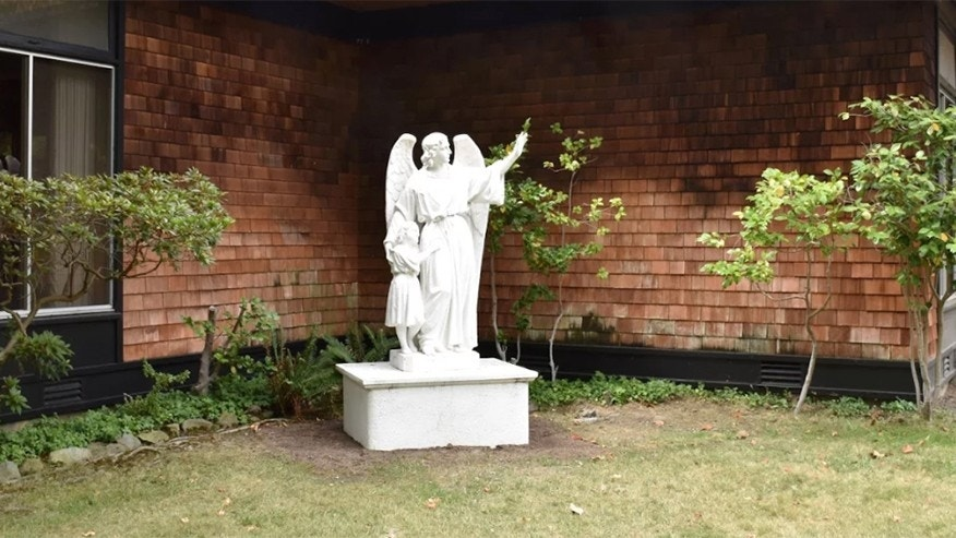 One of the current religious statues on San Domenico School's campus in San Anselmo. Parents expressed outrage after other statues were removed or relocated from the school's grounds.