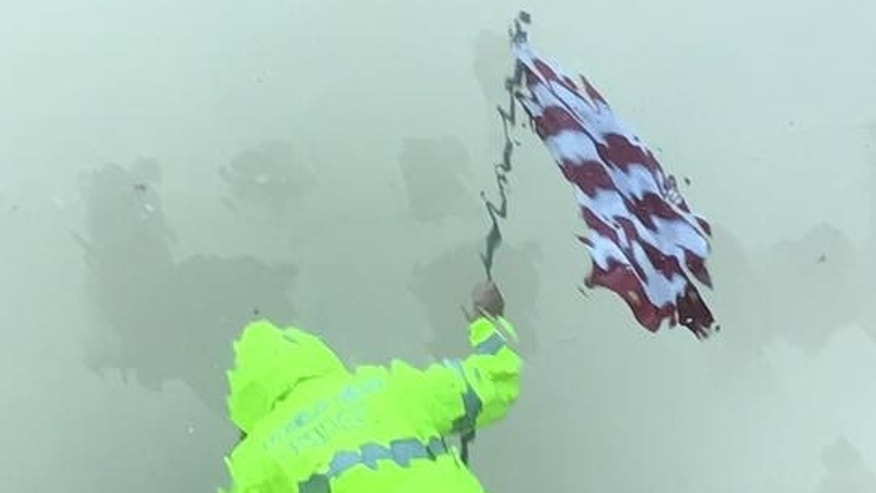 'Stop at nothing': Aransas Pass officer recovers American flag from Harvey rain