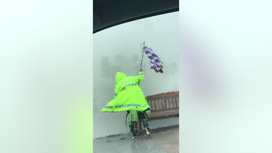 An Aransas Pass Police Department officer braved Hurricane Harvey on Friday to save an American flag.