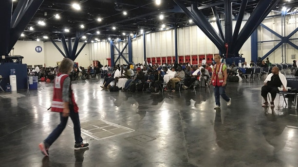 People seek shelter from the aftermath of Hurricane Harvey at the George R. Brown Convention